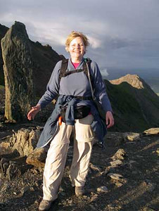 Near Scafell Pike's summit. Or at least she thinks she is. Actually she's nowhere near the summit, which is one of about 20 rock cairns across the plateau, which delight in confusing exhausted three-peakers, especially after dark, when they are believed to deliberately switch places with one another, and occasionally disappear entirely.