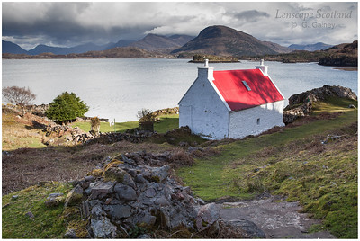 Red roofed cottage on Loch Shieldaig