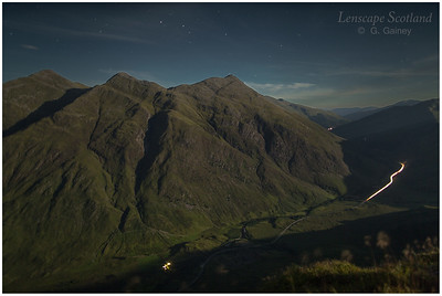 car headlight trails in Glen Shiel, below the Five Sisters of Kintail