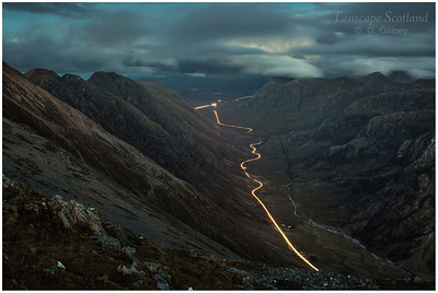 car headlight trails in Glen Coe, from Sgorr nam Fiannaidh
