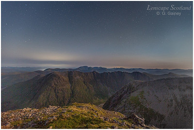 Starry sky over Ben Nevis and the Aonach Eagach ridge, from Stob Coire nam Beith