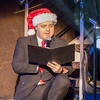 Assistant cruise director reads a traditional Christmas story