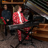 Keyboard player wins for the most festive holiday garb!