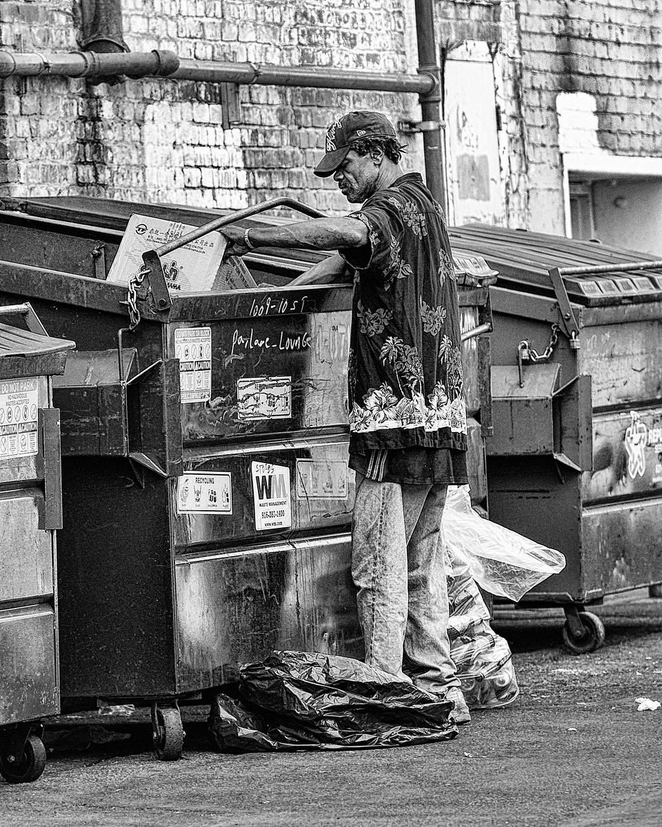 The Street - Homeless man digging through dumpster - 8341