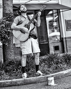 The Street John Davis singing gospel music for tips - 8399