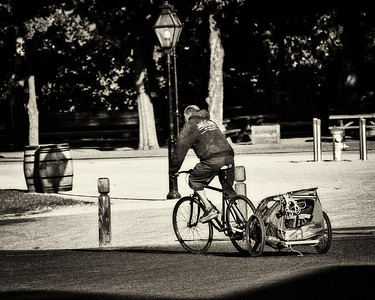 The Street - homeless man riding his bike - 3