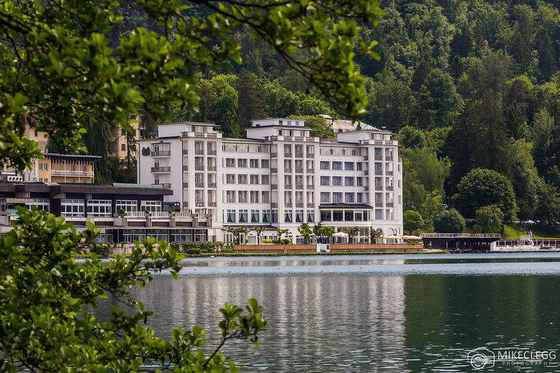 The outside of the Grand Hotel Toplice from across Bled Lake