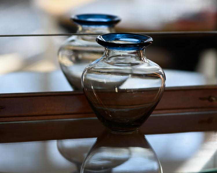 Blue-Rimmed Vase with Reflection