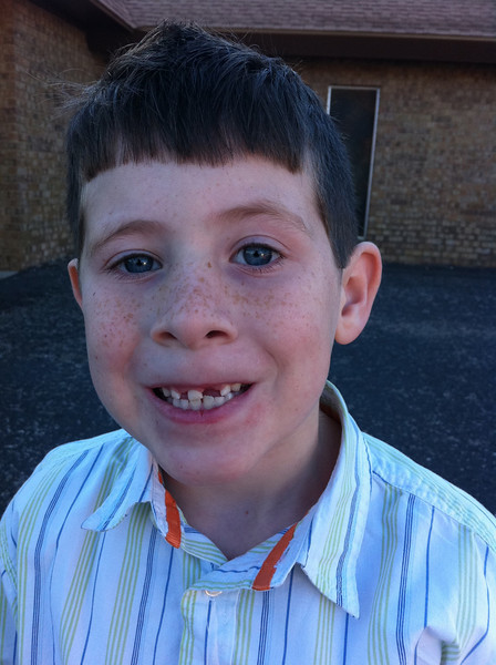 TJ lost a tooth. What a cute smile!!