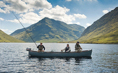 Doolough Delphi - Traditional style fly fishing from boat Delphi Fishery, Connemara, Ireland for sea trout and salmon. One angler is using the dapping method on a long rod.