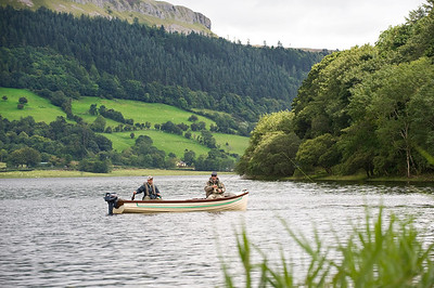 Glencar Lough - Fly anglers in boat with beautiful escaprment in distance. Stunning Irish landscape, Glencar, Sligo, Ireland
