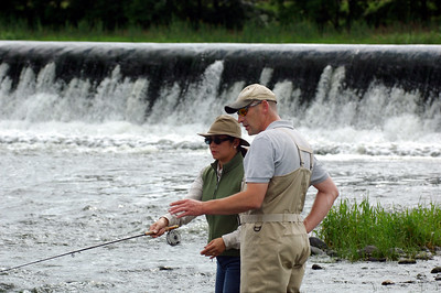 River Bann - Angling guide instructs female tourist salmon angler on River Bann, Co Derry, N. Ireland