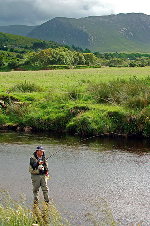 Reelan River - Fly angler fishing for salmon on the Reelan River, Cloghan, Co Donegal, Ireland