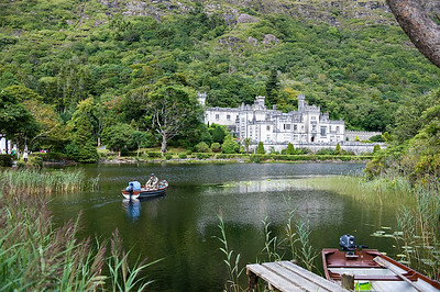 Kylemore Abbey - Anglers seting off in boat to fish for sea trout and salmon at Kylemore Abbey, Connemara, Ireland