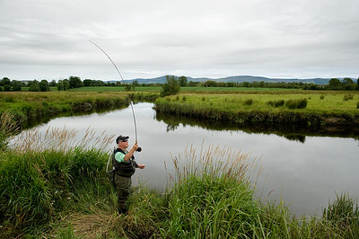 Castletown River estuary - Fly angler on the Castletown Rive,r Co. Louth, Ireland fishing for sea trout
