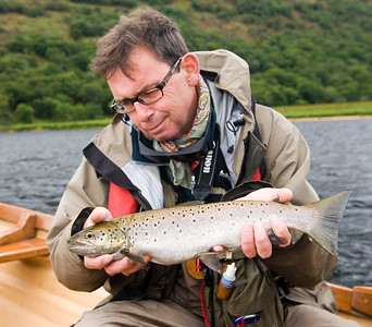 Lough Beagh - Angler with seatrout Glenveagh National Park,  Donegal, Ireland