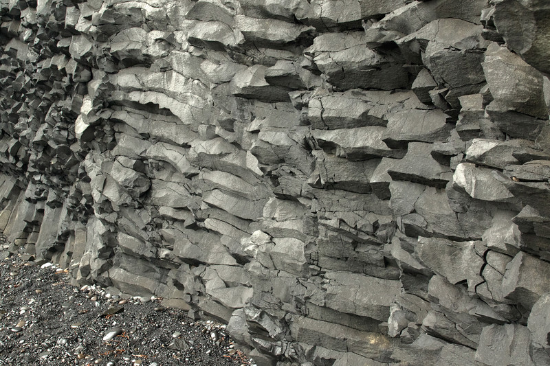 Polygonal columnar jointing of volcanic basalt rock - Reynisfjara (beach).