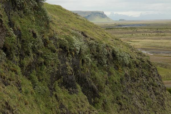 From the Fjaðrárgljúfur gorge - down to the Breiðbalkvísl (river) - beyond is the Þverárfjall (mountain) adjacent the Orustuhóll (hill) - and distal amongst the clouds is the Öræfajökull (glacier), the southernmost area of the Iceland's largest ice cap, the Vatnajökull.