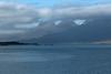 Berufjörður (fjord) - beyond the islets and Teigartungi (point) - up the slopes amongst the clouds to Mýrafellstindur (peak), then the jagged ridge of Bæjartindur (peak).