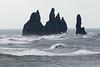 Reynisdrangar volcanic rock sea stacks amongst the breaking waves of the North Atlantic.