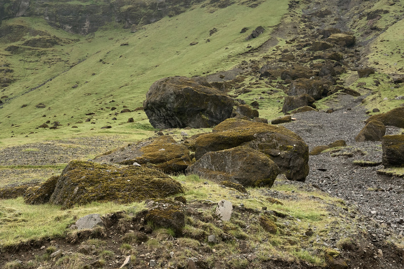Volcanic rock boulders or clasts upon a talus stream along the lower slope of the Steinafjall (mountain).