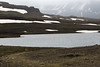 Heiðarvatn (lake) - along the  with beyond the snow banks along the Stafdalsfell (mountain) - distal the slope along the Strandarfjall (mountain) - Eastern region of Iceland.