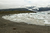Fjallssárlón (Mountain Lagoon), clustered with icebergs, bergy bits and growlers - beyond to the edge of the Fjallsjökull (glacier) - then up along the Hrútárjökull, an outlet glacier on the eastern margin of the Öræfajökull, the 3rd largest central volcano in Iceland, with a basalt rock caldera measuring about 4.5 mi² (11.6 km²) and around 2,135 ft. (650 m) deep, which is ice-filled (about 1,770 ft./540 m thick), and the basal diameter of about 14 mi. (22.5 km).