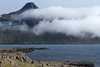 From Vattarnestangi (point) at the southern mouth into the Reyðarfjörður (fjord) - across to and above the clouds is the Snæfugl (peak), rising to about 2,484 ft. (757 m) at the northern mouth of the fjord - Eastern region of Iceland.