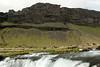 A cascade falls along the Fossalar (river) - amongst the Brunahraun (lava field) - with above the Þverárfjall (mountain).