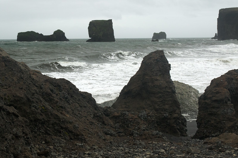 Dyrhólaey promontory - from (l to r), Lundadrangur, Háldrangur, Soðulsker, with directly beyond the Mávadrangur, and the Litlidrangur, just beyond the Tó (the southernmost end of the Dyrhólaey) - Southern region of Iceland.