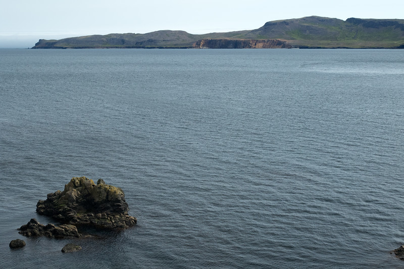 From the islet upon the Norðfjarðarflói (bay) - across to the Barðsnes (peninsula) - Eastern region of Iceland.