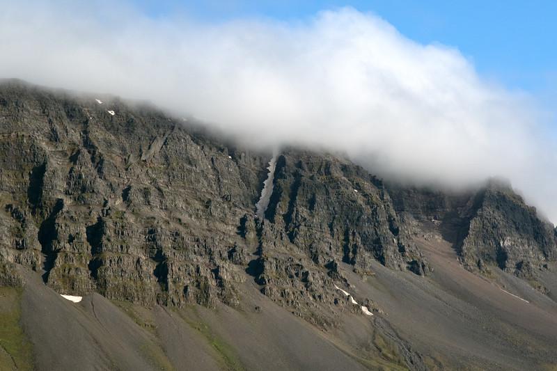 Cloud bank along the ridge of the Krossavíkurfjöll (mountains) - southern slope along the Vopnafjörður (fjord) - Eastern region of Iceland.
