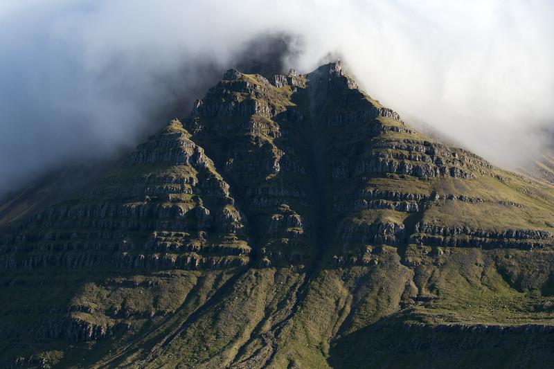 Lambafell (mountain) - along its northern slope and alluvial streams amongst the cloud bank.