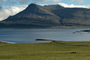From the mostly grassland slope down to the Skaflavíkurtangi (point), during mid-ebb tide - to the islets just off the Selnes (peninsula) in the Breiðdalsfjörður (Wide Valley Fjord) - and distal is the Ósfjall (mountain), from the Goðaborg, up the ridge to the Sátur, peaking at around 2,250 ft. (716 m) - Eastern region of Ieland.