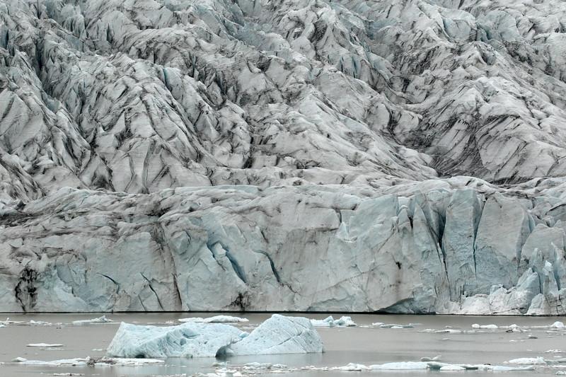 Terminus snout of the Fjallsjökull (Mountain Glacier) - among the recently calved glacial ice upon the Fjallssárlón (lagoon).