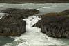 Skjálfandafljót River - a jökulá (glacial river), here displaying its glacial milk/flour amongst the volcanic rock.