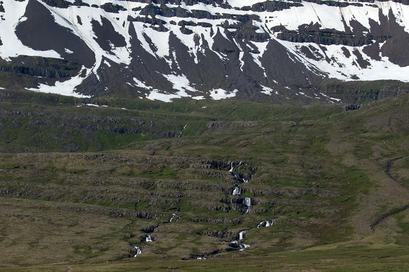 Up the cascading falls along the Naustaá (river), to the snow banks along the Hvalfjall (mountain).