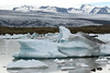 Fjallssárlón (lagoon), with glacial ice afloat - across the lateral moraine - up the glacial till cloaked ice of the Breiðamerkurjökull outlet glacier - to the volcanic rock slopes and ridges along the Esjufjöll (mountains), a nunatak (rock islands, surrounded by glacial ice).