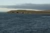 Across the Hólsvík (bay) - to Ormarslónshöfðhi (cape) -  with the Súlur slope distal - Northeastern region of Iceland.
