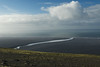 From atop the Hjörleifshöfði (Hjörleifur´s Headland), a volcanic rock promontory - viewing down to to the Mosalandskvísl (river), along the Mýrdalssandur (sand) outwash plain - flowing into the North Atlantic - with the stratocumulus clouds above.