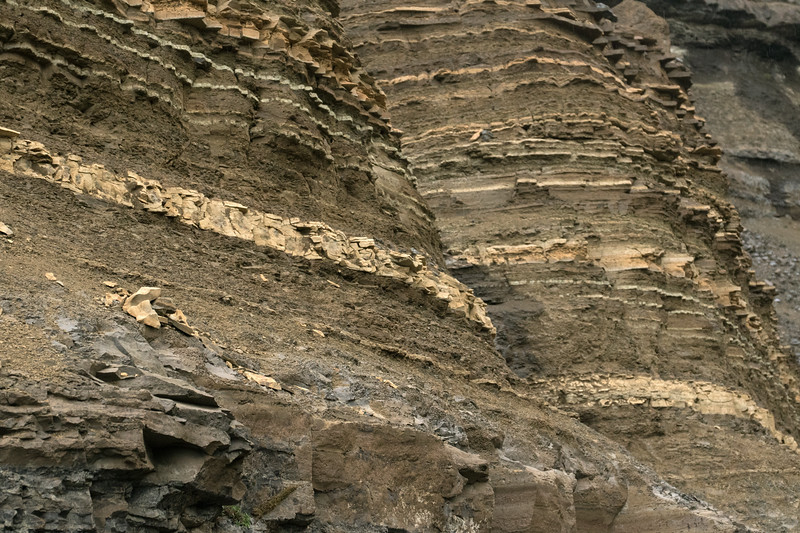 Sedimentary and Igneous rock strata along the slope and deepest section of the Hengifossgljúfur (gorge).