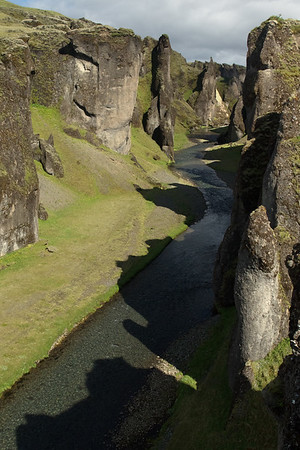 Shadows of the craggy slopes and jagged ridges, along the Fjaðrárgljúfur (Feather River Gorge).