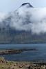 Vattarnestangi (point) - across the mouth of the Reyðarfjörður (fjord) - to amoungst the clouds, the Snæfugl (peak).