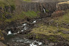 Hengifossá (river) - waterfall sourced from the Sellækur (stream) - fallen and eroded volcanic rock boulders along the Hengifossgljúfur (gorge).