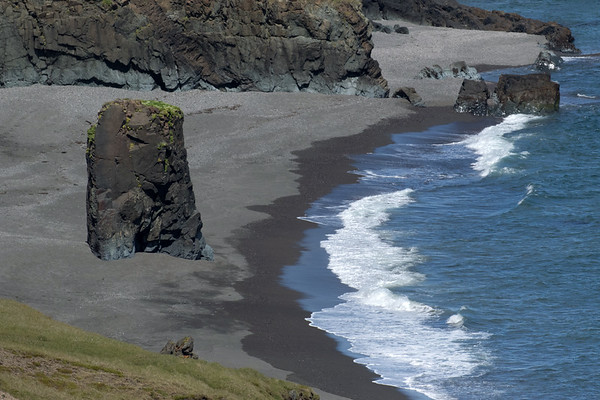 North Atlantic waves breaking upon the volcanic sand/pebble beach, during mid-flood tide.