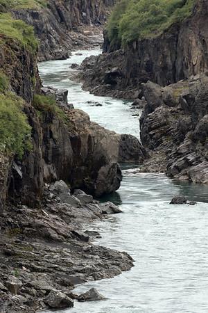 Volcanic rock banks between the headlands of the Jökulsárshlíd and Hróarstunga - here along the glaciel water of Brú (river) - Eastern region of Iceland.