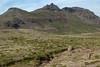 Up the Rauðafell (mountain) to the Söðulhnjúkur (summit) - then the Flatafjall (mountain) and the Berutindur (peak) rising to around 2,625 ft. (800 m).