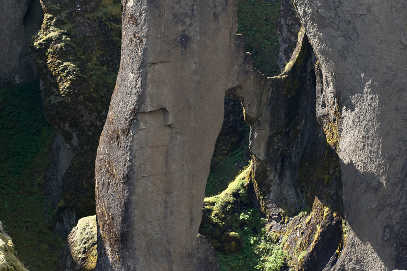 A volcanic palagonite rock arch, clustered with lithophytic moss and lichen - located along the western wall of the Fjaðrárgljúfur (Feather River Gorge).