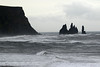 Beyond the breaking Atlantic waves - to volcanic rock pillars of the Reynisdrangar, rising about 200 ft. (60 m)  - adjacent the end of the Gyldarhóll (hill).