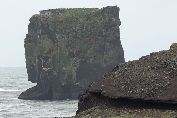 Dyrhólaey, volcanic rock promontory - out to the Háldrangur (pillar), a volcanic rock sea stack, rising to about 140 ft. (43 m).